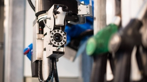 A Neste petrol station in Finland uses a robot arm to fuel people's cars