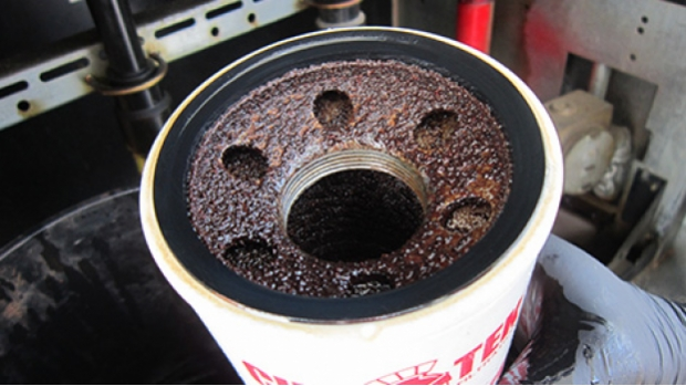 Corrosion on the inside of a filter removed from diesel dispenser